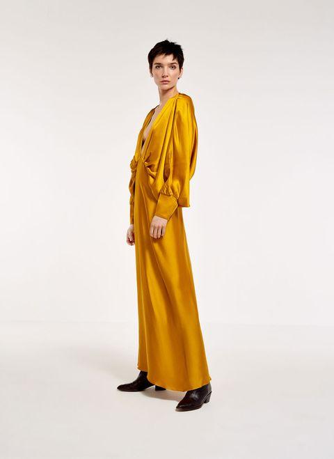 Sleeve, Standing, Costume, Costume design, Silk, Monk, Fashion design, Fashion model, Robe, One-piece garment,