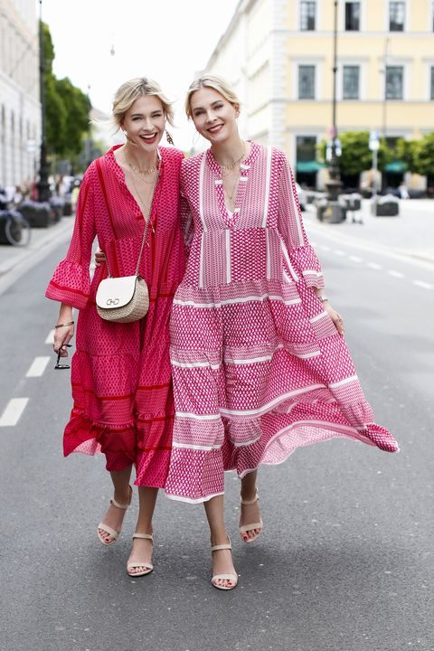 munich, germany   june 03 advertising twins nina meise and julia meise, waering a red pink and a red white bohemian style maxi dress by mooi fashion berlin, a small bast fiber bag by hm and nude sandals by hm during a street style shooting on june 3, 2020 in munich, germany photo by streetstyleographgetty images