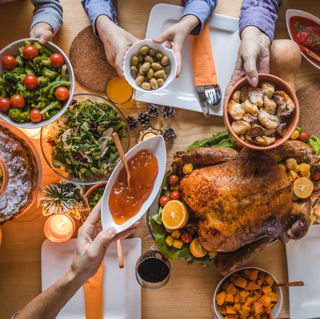 above view of passing food during thanksgiving dinner