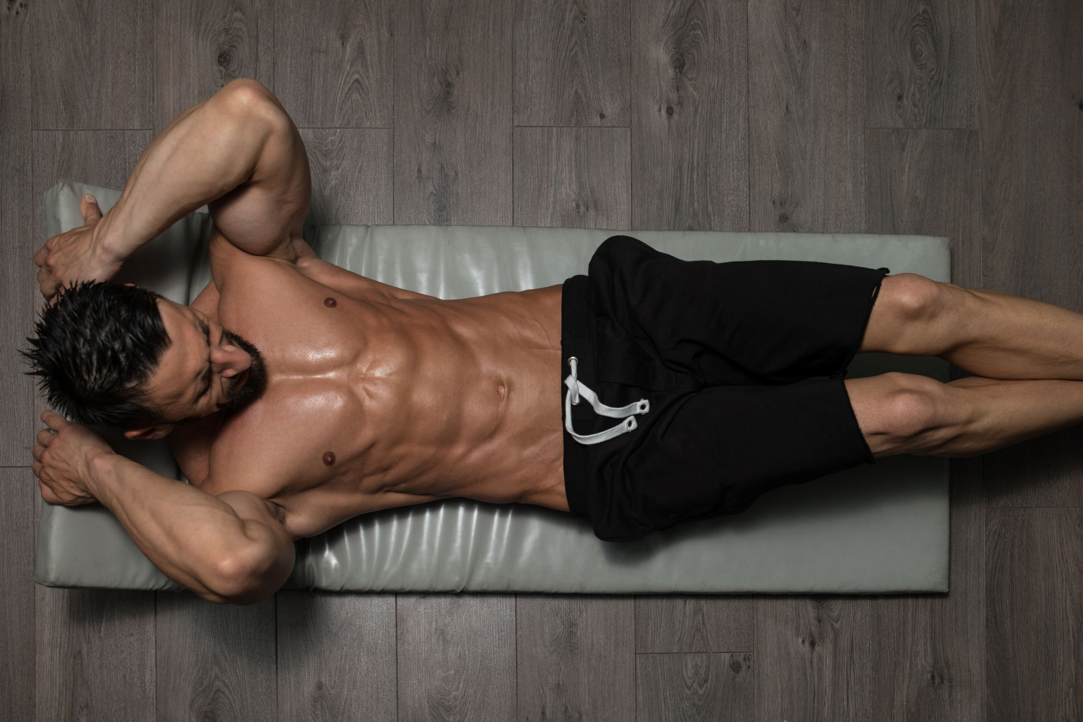 Sick of Boring Ab Workouts? Try These Hollow Holds.