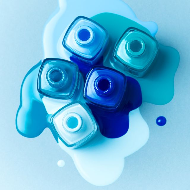 Abstract Composition of Blue Colored Nail Polish Bottles