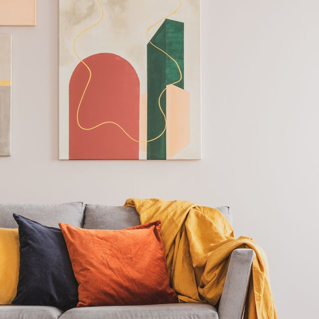abstract painting hanging on living room wall