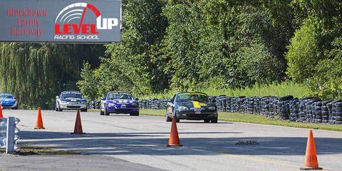 Motor vehicle, Vehicle, Land vehicle, Automotive parking light, Car, Road surface, Logo, Asphalt, Automotive lighting, Thoroughfare,