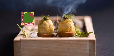 aceitunas de españa con un plato de aceitunas gordal