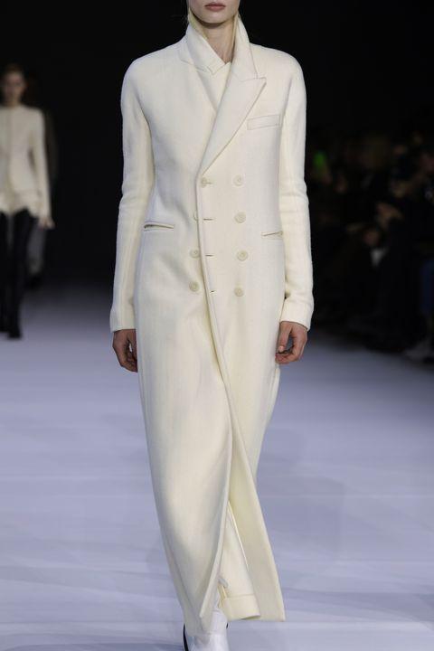 Fashion, Fashion model, Clothing, Fashion show, White, Runway, Haute couture, Human, Outerwear, Formal wear,