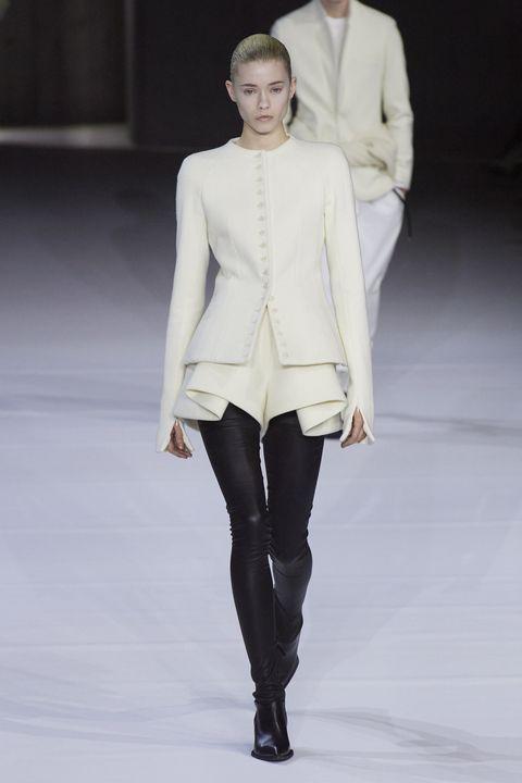 Fashion, Fashion model, Fashion show, Runway, White, Clothing, Haute couture, Outerwear, Human, Fashion design,