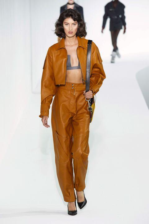 Fashion show, Fashion, Fashion model, Runway, Clothing, Brown, Outerwear, Human, Trousers, Fashion design,