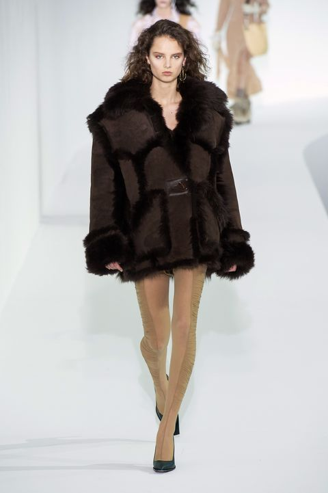 Fashion model, Fashion show, Fashion, Clothing, Fur clothing, Fur, Runway, Shoulder, Haute couture, Outerwear,