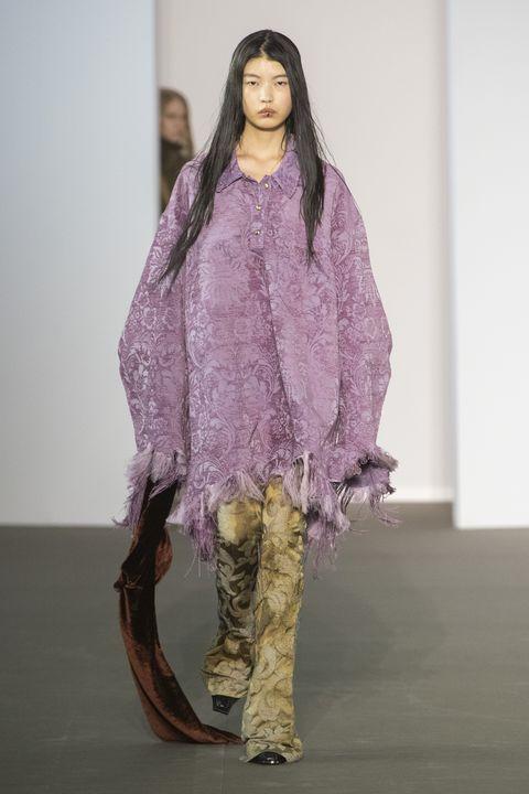 Clothing, Fashion, Purple, Fashion design, Fashion show, Fashion model, Long hair, Costume, Outerwear, Haute couture,