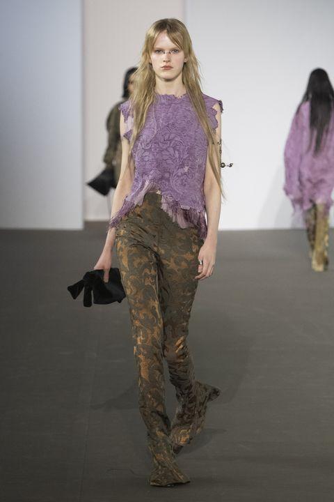 Fashion, Fashion show, Fashion model, Runway, Clothing, Fashion design, Trousers, Camouflage, Textile, Long hair,
