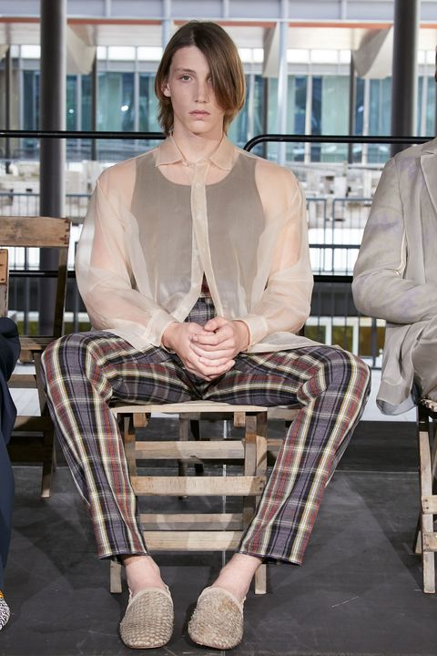 Clothing, Sitting, Fashion, Beige, Leg, Design, Outerwear, Street fashion, Tartan, Photography,