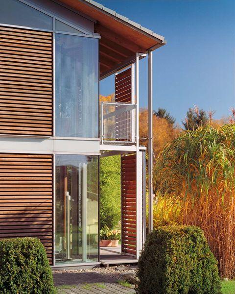 acristalamientos eficientes casa con grandes ventanales