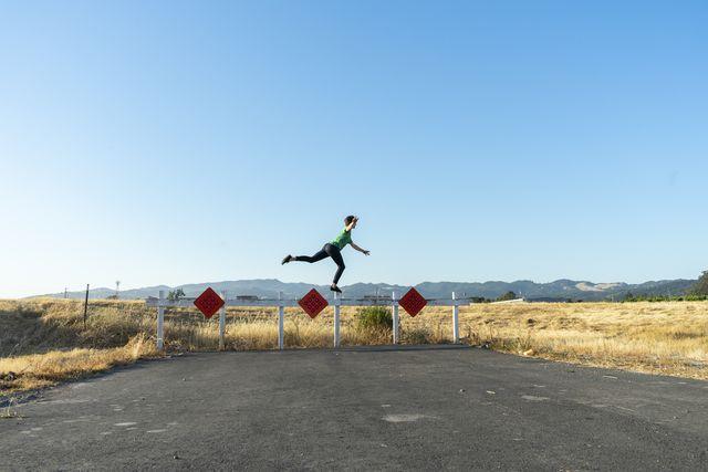 acrobat balancing on barrier