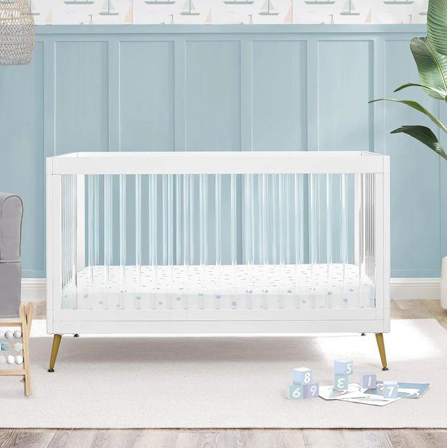 acrylic crib in blue nursery