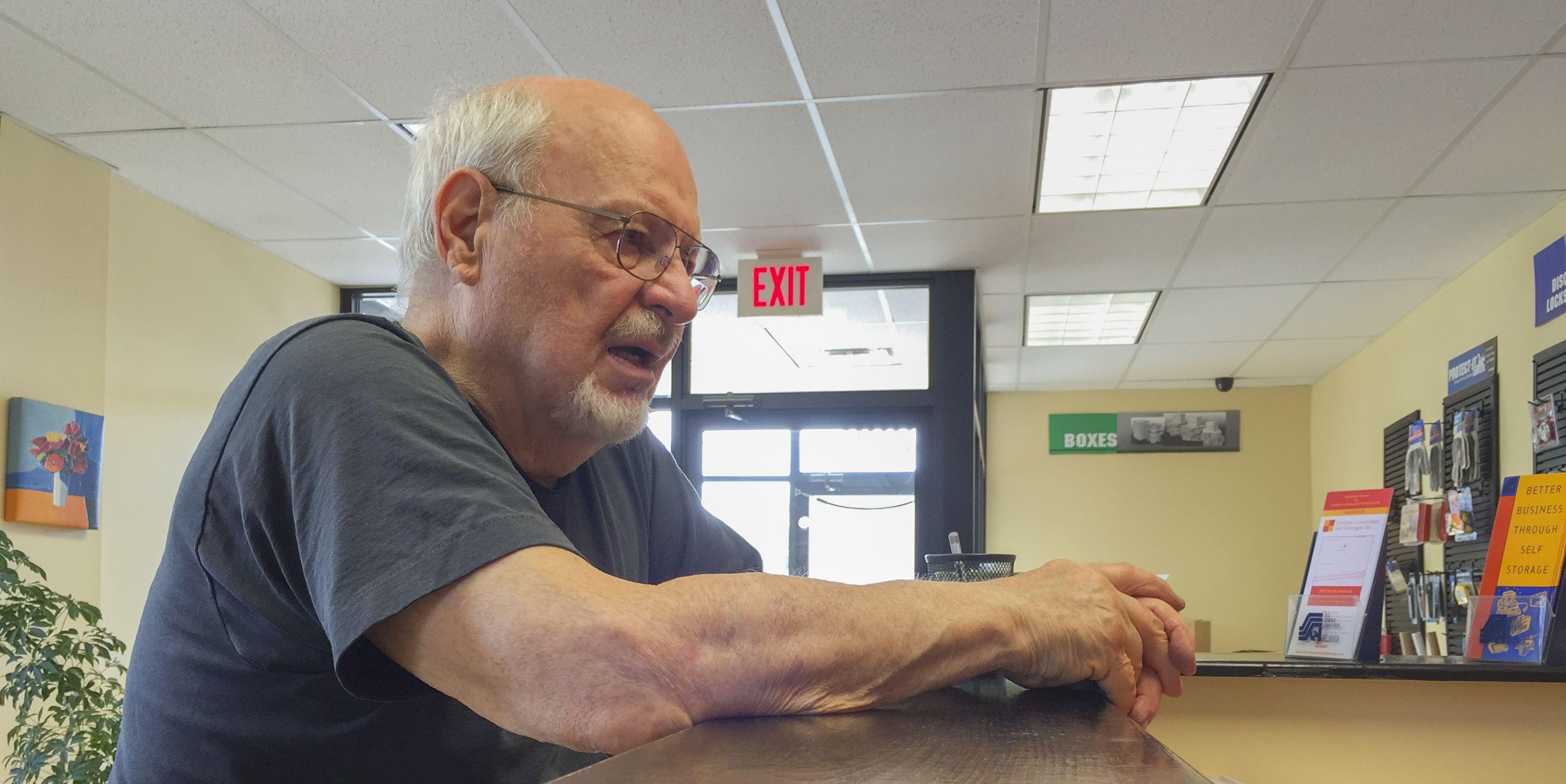 Active Senior At Customer Service Counter