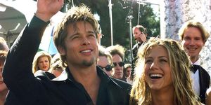 Actor Brad Pitt (L) waves to spectators as he arri