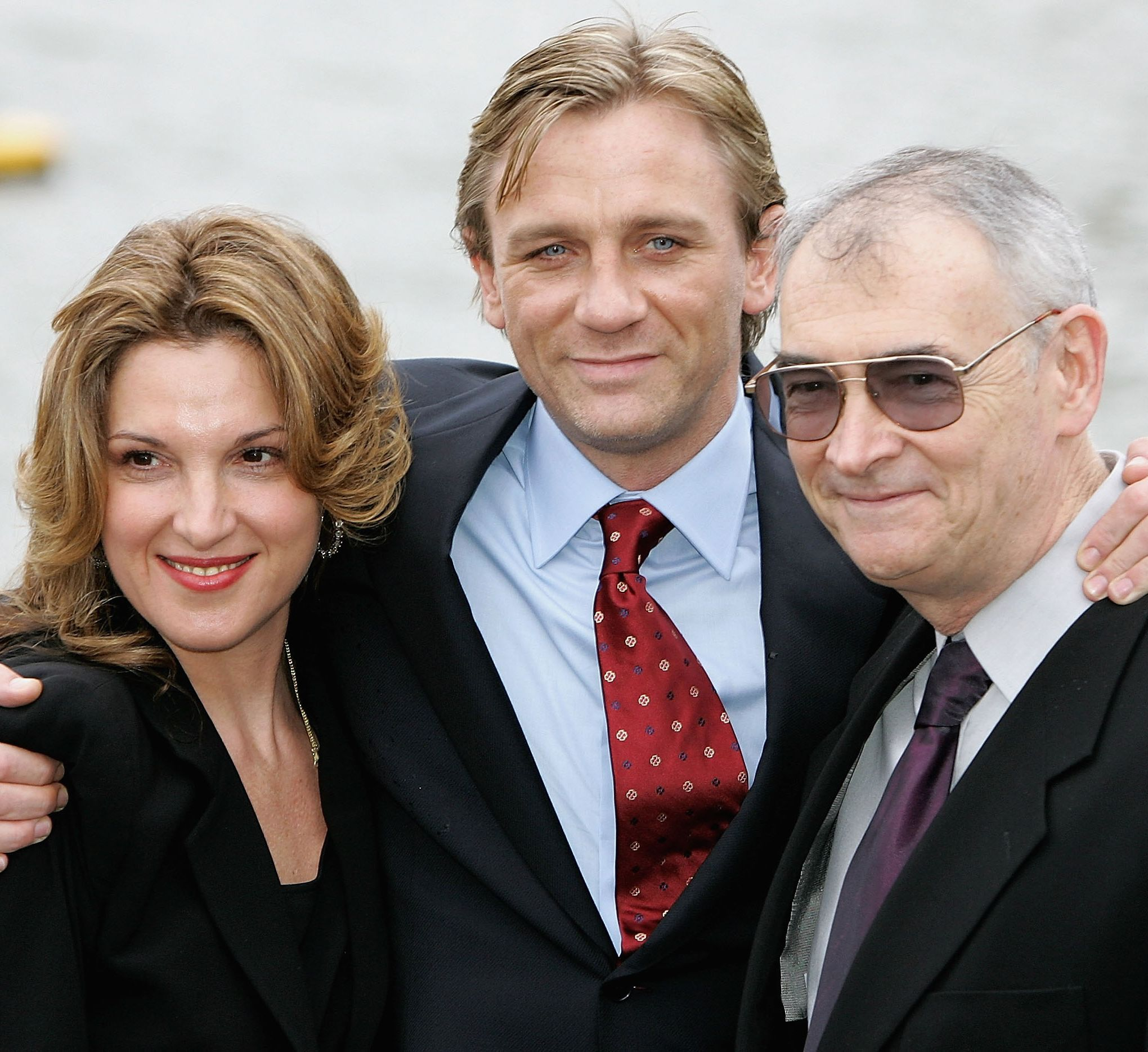 Daniel Craig with Broccoli and her stepbrother Michael G. Wilson in 2005.