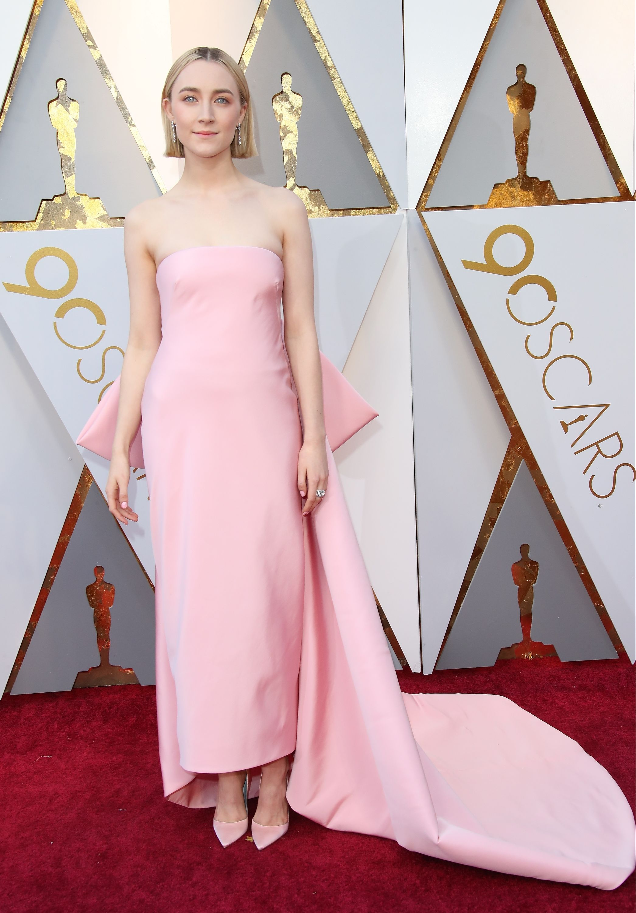Ronan looked sweetly angelic in a blush pink strapless and cropped Calvin Klein gown that had an enormous bow at the back for the 2018 Oscars.