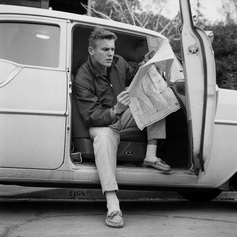 tab hunter posing in a car