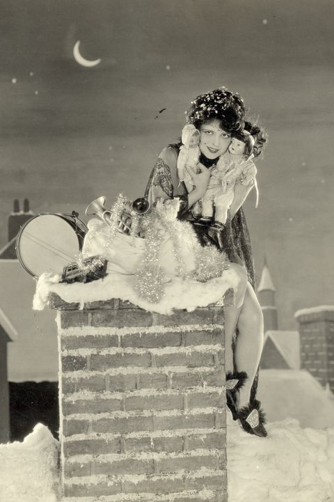 clara bow sitting on chimney with toys