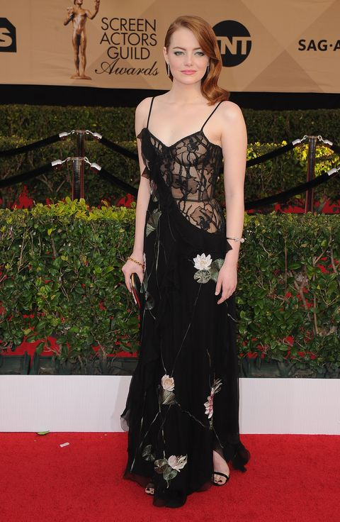 Emma Stone Wears Gold Bow Pantsuit To Screen Actors Guild