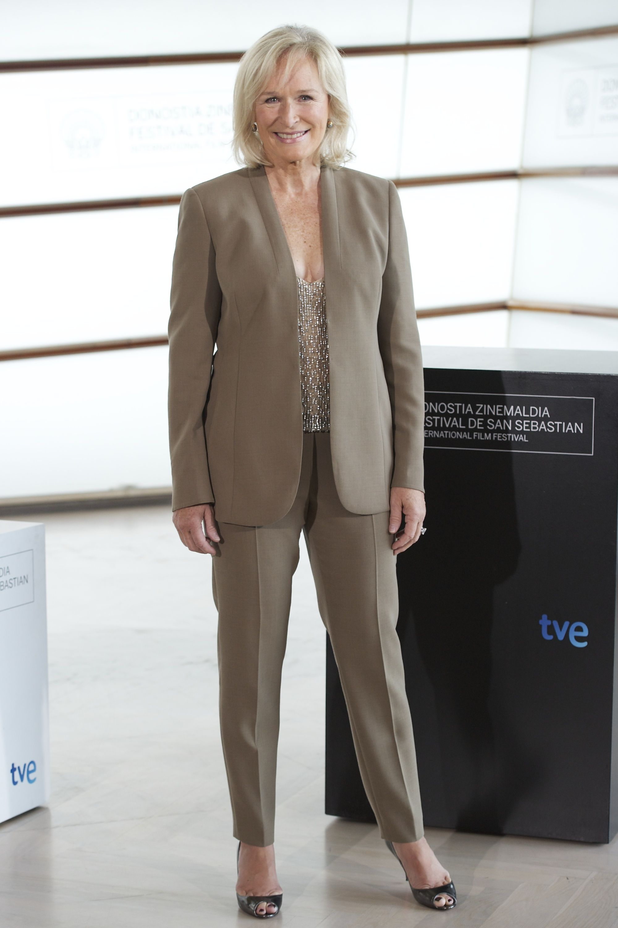 Glenn Close wore a beige pant suit with a beaded top and a pair of metallic heels while promoting her film Albert Nobbs the San Sebastian International Film Festival.