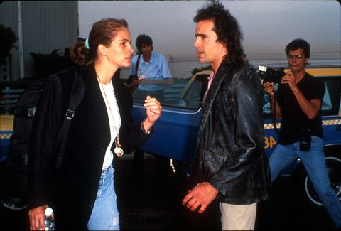 Actress Julia Roberts talks with actor Jason Patric...