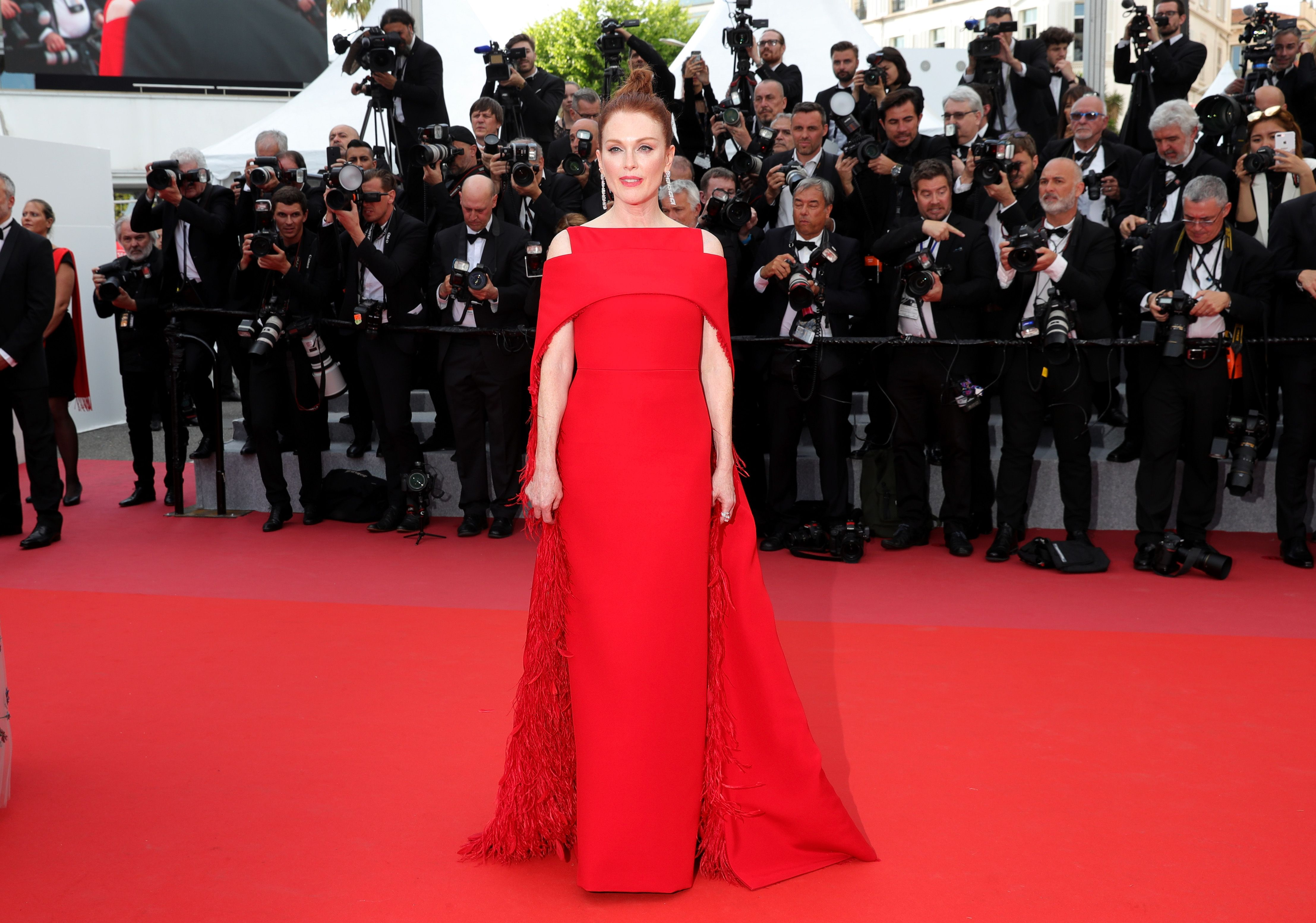 Moore was the picture of elegance in simple scarlet Givenchy gown that was elevated with a cape attachment with feathering on the underside at the 2018 Cannes Film Festival.