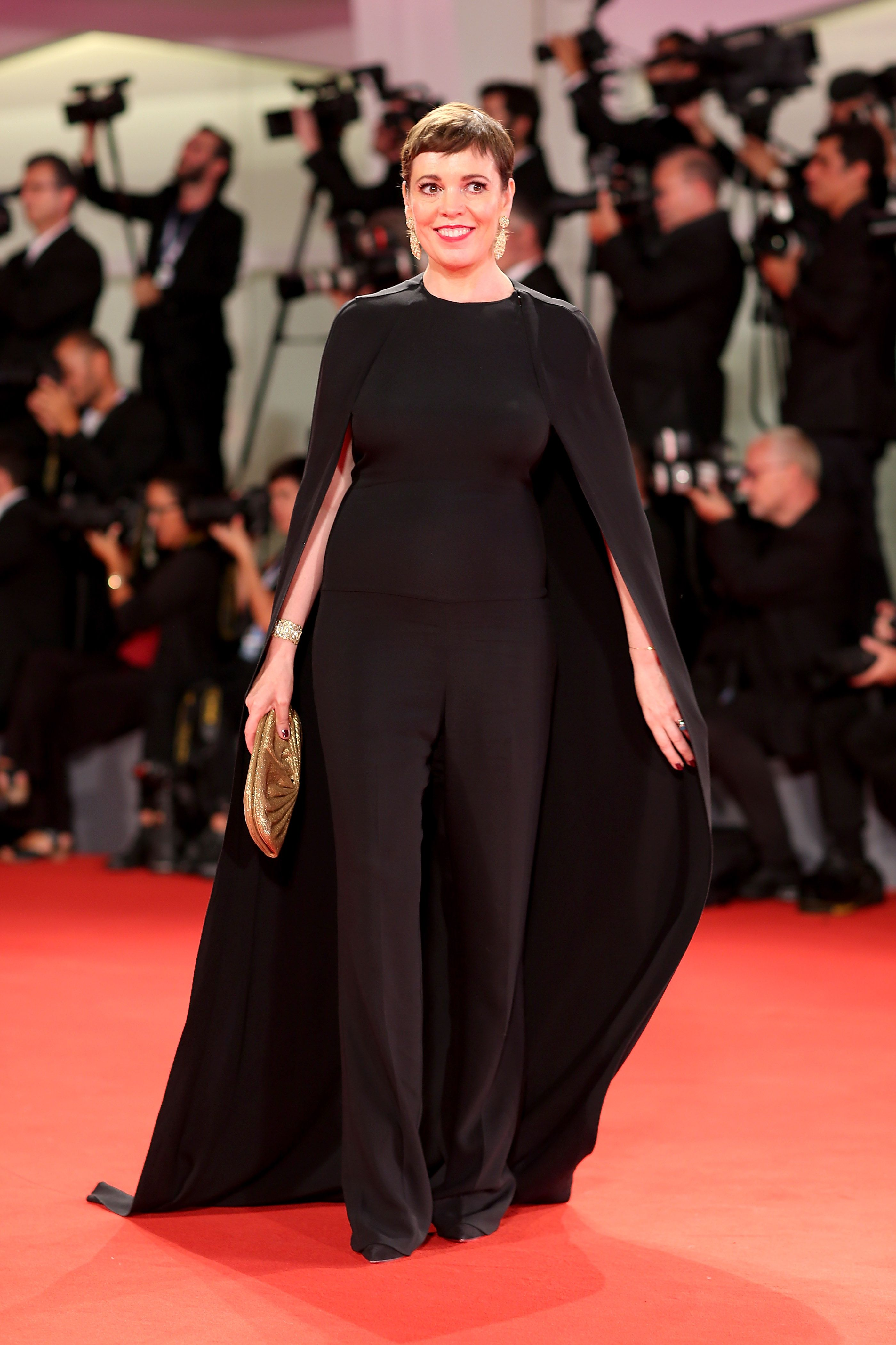 The actress wore a black jumpsuit with an elongated cape, statement diamond earrings, and a gold clutch for another day of the Venice Film Festival.