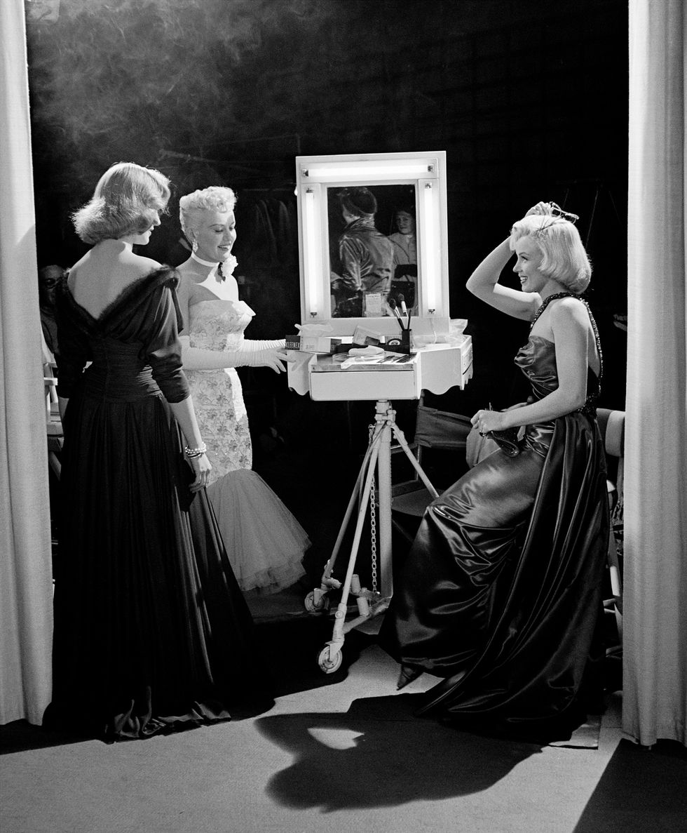 This image has an empty alt attribute; its file name is actresses-betty-grable-lauren-bacall-and-marilyn-monroe-on-news-photo-1584553801.jpg