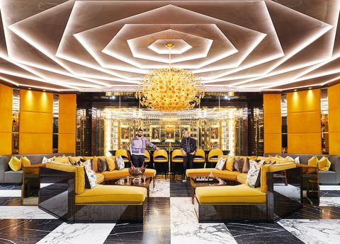 Lobby, Yellow, Interior design, Room, Ceiling, Building, Property, Lighting, Wall, Furniture,