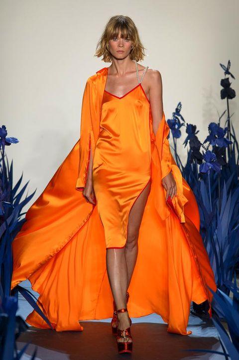 Fashion model, Fashion show, Fashion, Clothing, Orange, Runway, Dress, Haute couture, Yellow, Fashion design,