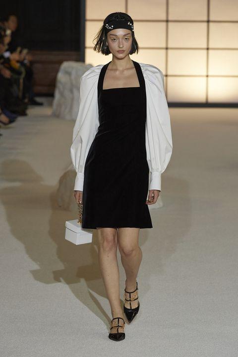 Fashion model, Fashion, Fashion show, Runway, Clothing, Shoulder, Dress, Haute couture, Fashion design, Joint,
