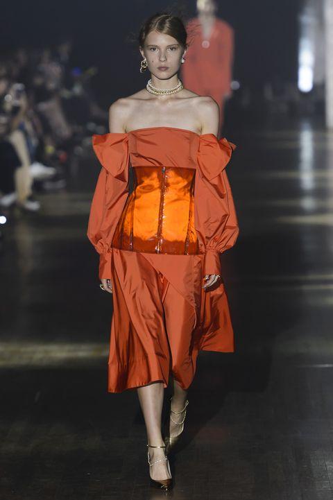 Fashion model, Fashion, Fashion show, Runway, Orange, Shoulder, Yellow, Fashion design, Haute couture, Joint,