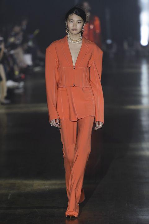 Fashion, Fashion model, Runway, Fashion show, Clothing, Suit, Pantsuit, Haute couture, Orange, Human,