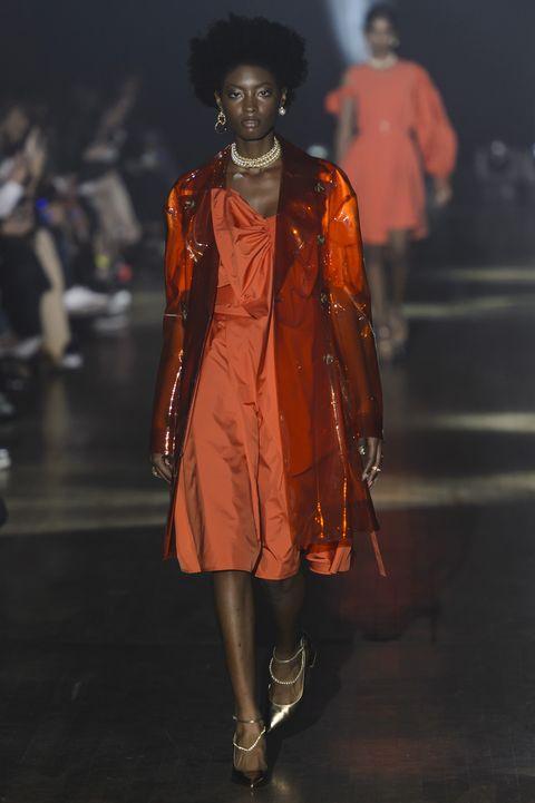 Fashion, Runway, Fashion show, Orange, Fashion design, Fashion model, Human, Outerwear, Event, Haute couture,
