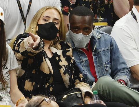 phoenix, arizona   july 17 singer adele looks on next to rich paul during the first half in game five of the nba finals between the milwaukee bucks and the phoenix suns at footprint center on july 17, 2021 in phoenix, arizona note to user user expressly acknowledges and agrees that, by downloading and or using this photograph, user is consenting to the terms and conditions of the getty images license agreement  photo by christian petersengetty images