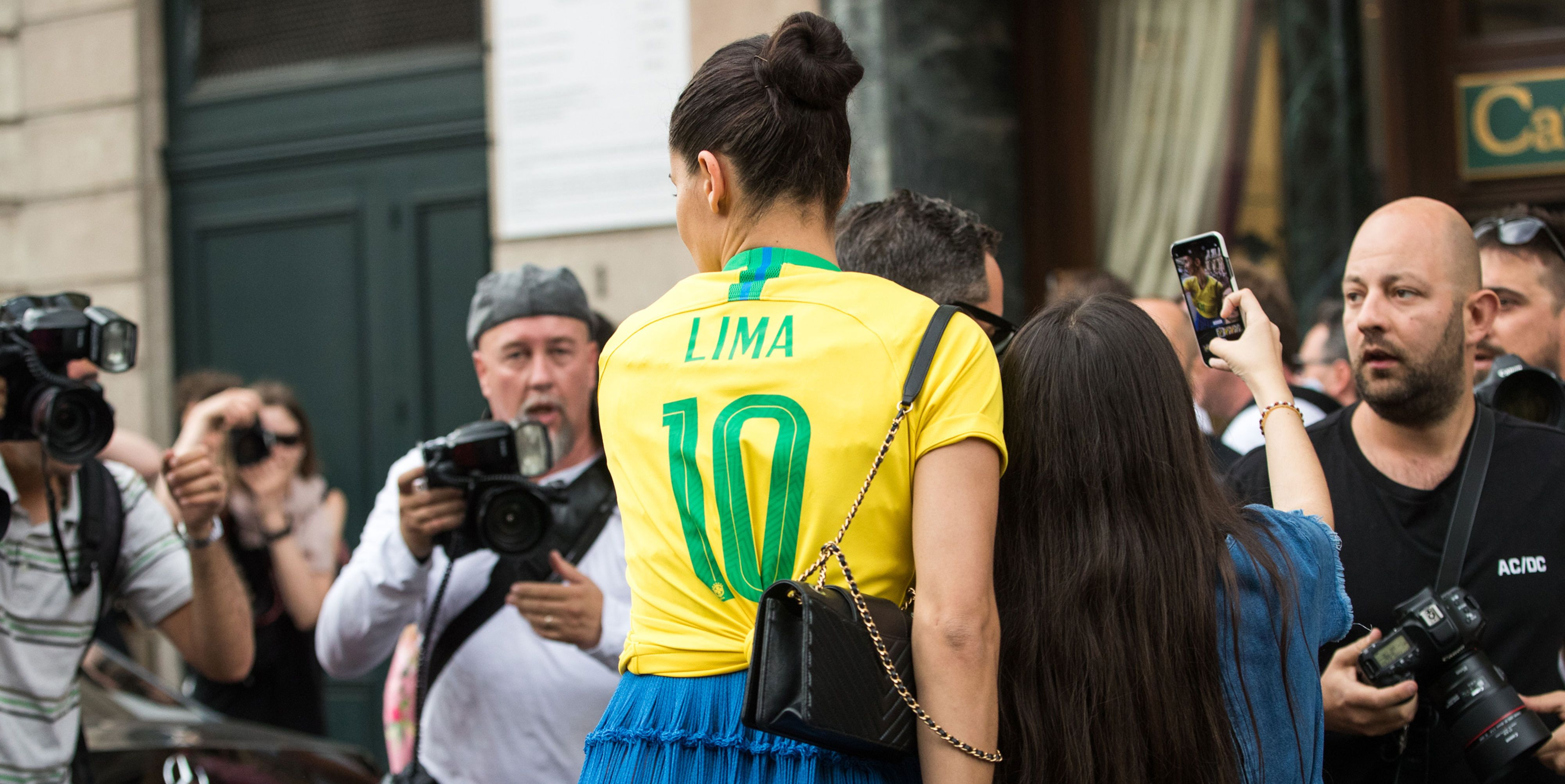 Adriana Lima wearing a Brazilian football during Couture Fashion Week