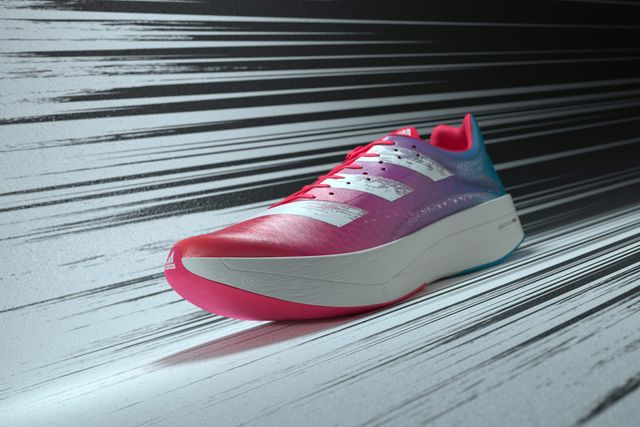 a pink and blue running shoe with white accents