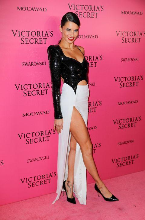 Clothing, Fashion model, Beauty, Shoulder, Leg, Pink, Cocktail dress, Joint, Footwear, Dress,