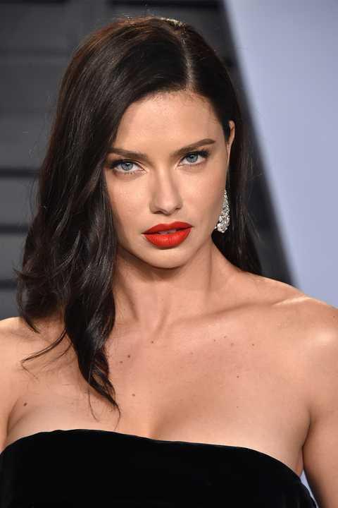 Mouth, Lip, Hairstyle, Skin, Shoulder, Eyebrow, Eyelash, Strapless dress, Style, Fashion model,