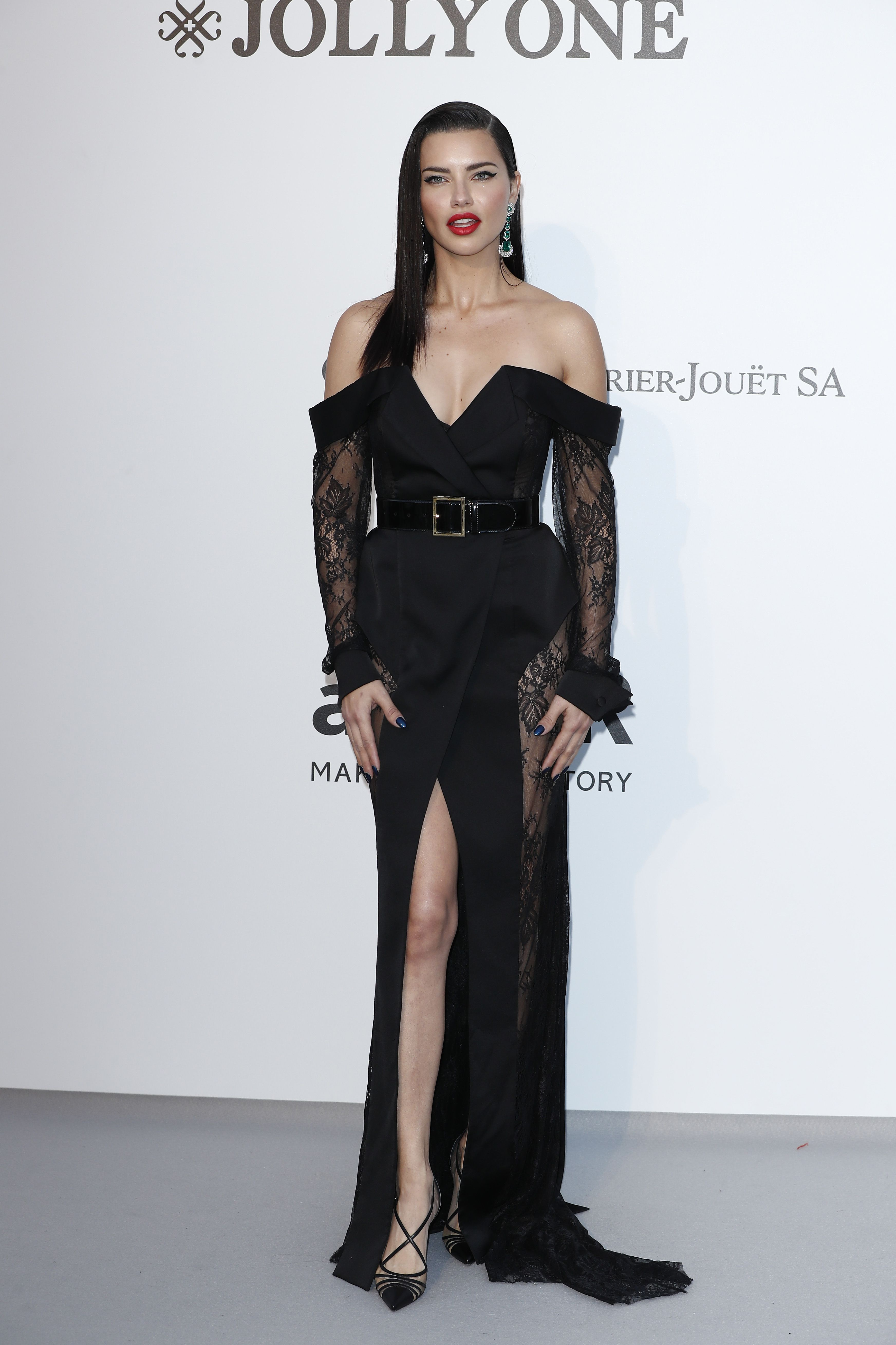 Adriana Lima In a black off-the-shoulder long sleeved gown by Ester Abner.