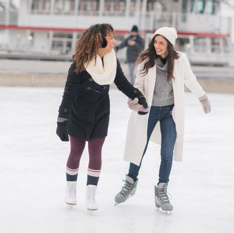 winter date ideas - Adult Female Couple Ice Skating