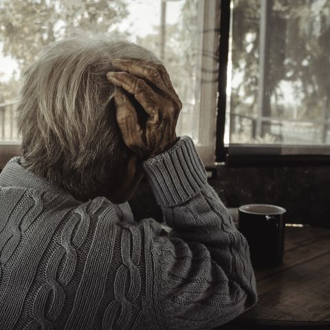 adult woman, old person has a headacheconcept loneliness dementia abuse sadnesshealthcare