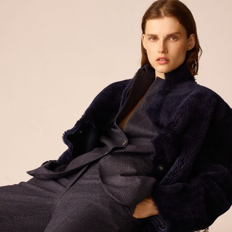 Clothing, Fur, Outerwear, Sitting, Robe, Fur clothing, Overcoat, Neck, Wool, Coat,