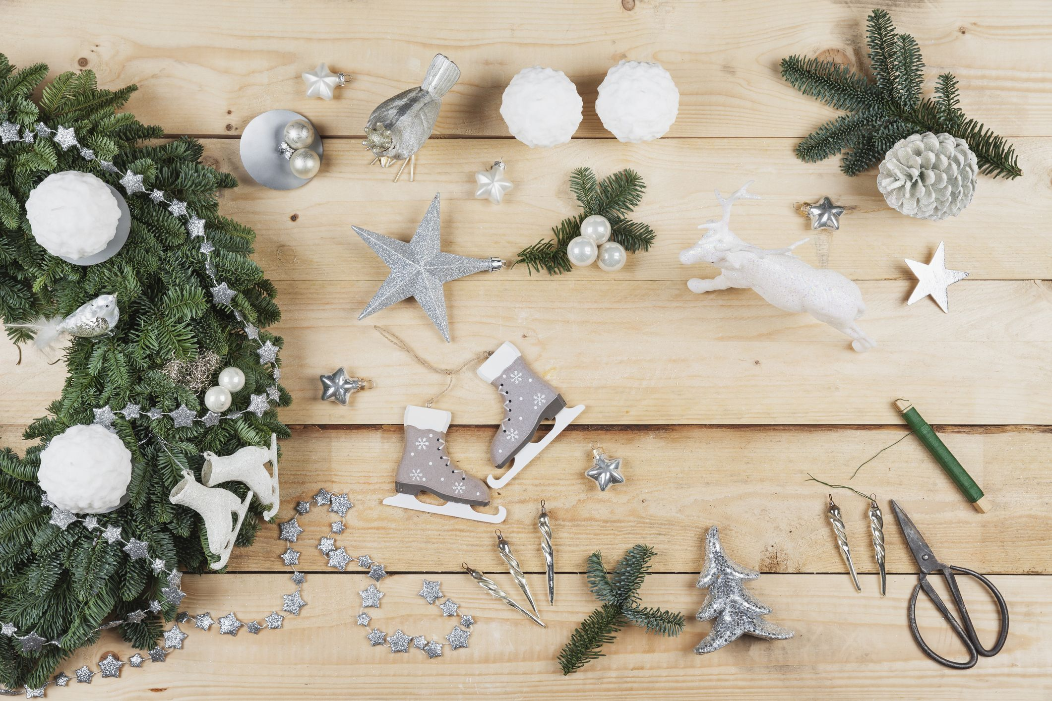 Advent wreath decoration items, self-made advent wreath with real fir tree green, DIY, glitter deer, snow ball candles, skates, birds, Christmas baubles, vintage icicles, wire, stars, scissors, fir cone