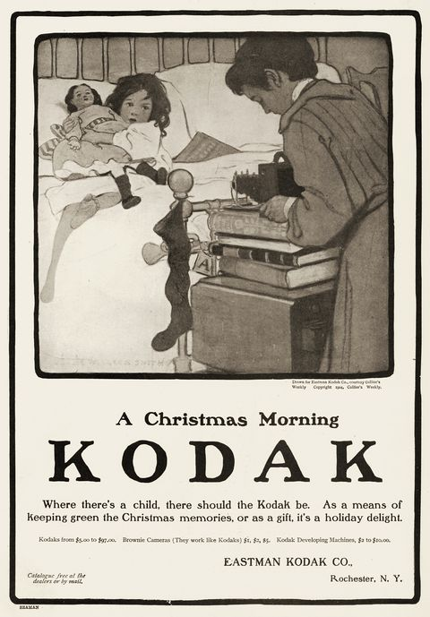mother and children playing with kodak camera in vintage holiday ad