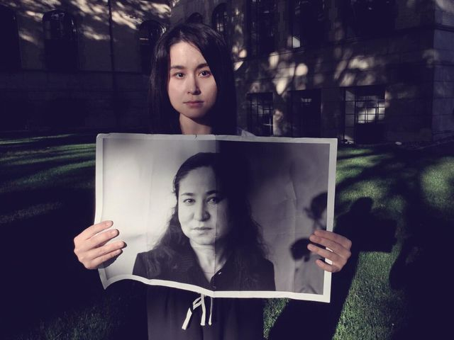akida pulat holds a photo of her mother, rahile dawut, a famous uyghur anthropologist who has been disappeared by china