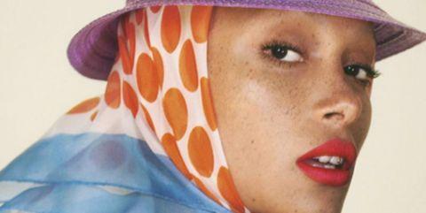 Clothing, Lip, Orange, Hat, Beauty, Skin, Sun hat, Fashion accessory, Scarf, Headgear,