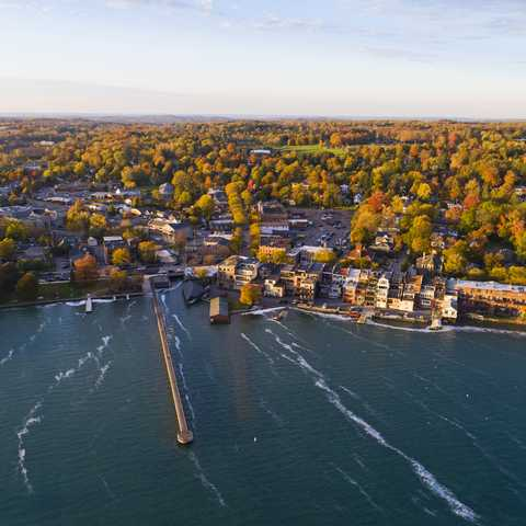 Aerial of Small Village on Lakeshore in Autumn